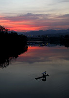 Yunnan - Xishuangbanna Pole Raft at Sunset