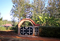 Arched Gate in Kianjai with Bananas